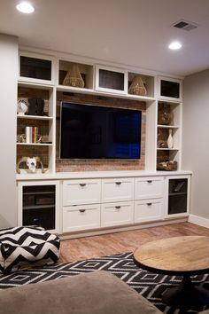 white built in entertainment center with exposed brick | suburban bitches
