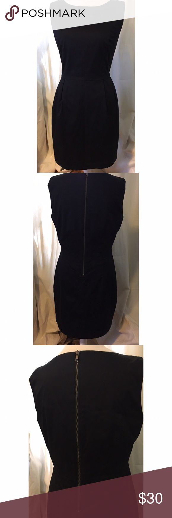 H&M black shift dress with pockets. Size 14 Black shift dress with pockets and silver zipper detail in the back. Worn once. Great condition. H&M Dresses