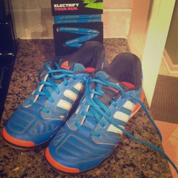 Youth Indoor soccer shoes + FREE NEW shoe laces Indoor soccer shoes. Good condition. One shoe lace is cut short so adding in a free pair of brand new brooks shoe laces! Adidas Shoes