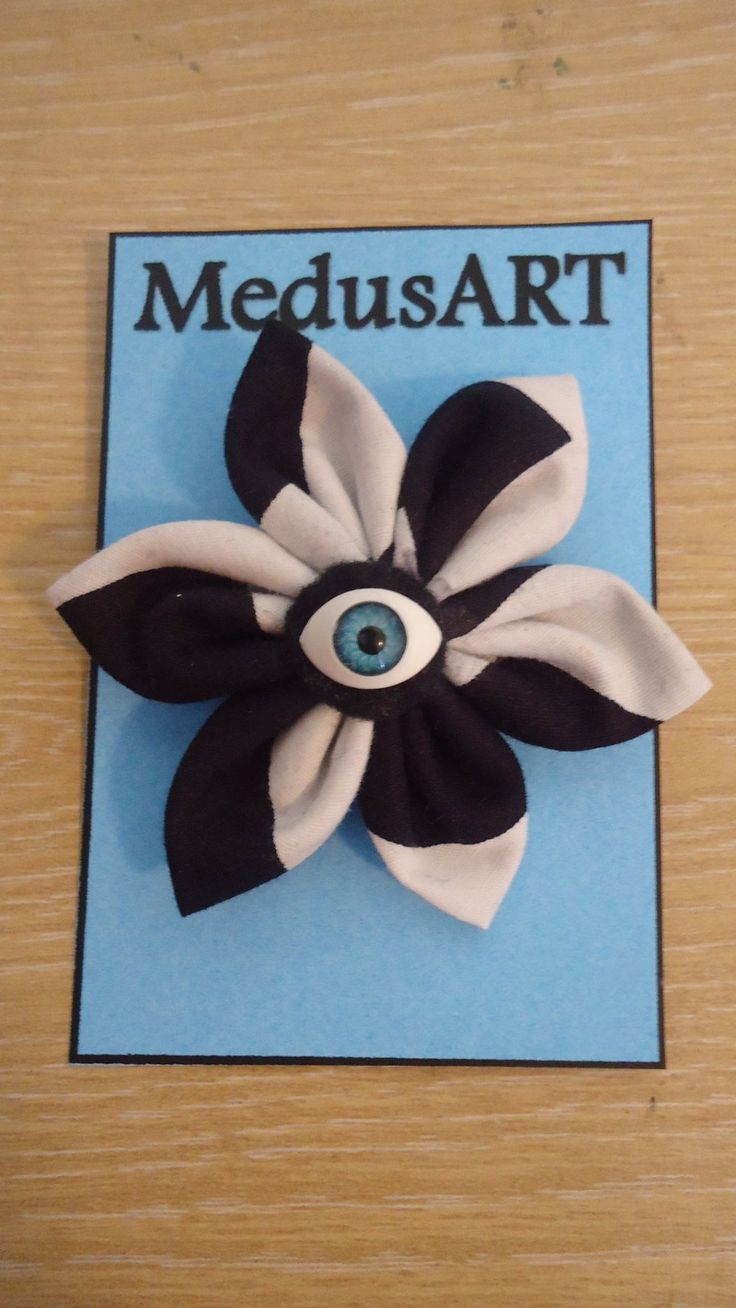 Handmade Black and White Zigzag Fabric Flower Brooch - $7.00. (Postage not included)  This is made to order. Please allow 1-2 days for me to make it up.  Due to pattern on fabric designs may vary slightly from the original. www.facebook.com/MedusARTIST