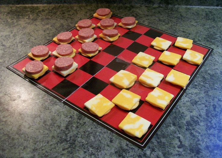 Crackers, Cheese & Pepperoni are a simple way to create an edible checkerboard! Cute after school snack idea....with a little Saran wrap over the board.