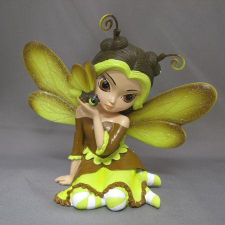 Feisty as a Firefly shows even the smallest inhabitants in the garden can find friendship. This wide eyed fairy is from the Cute as a Bug Figurine Collection by artist Jasmine Becket-Griffith.