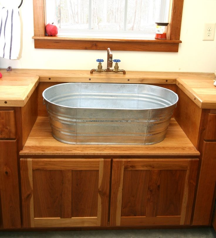 I would LOVE this in my home!  Rustic Laundry Sink And Cabinet