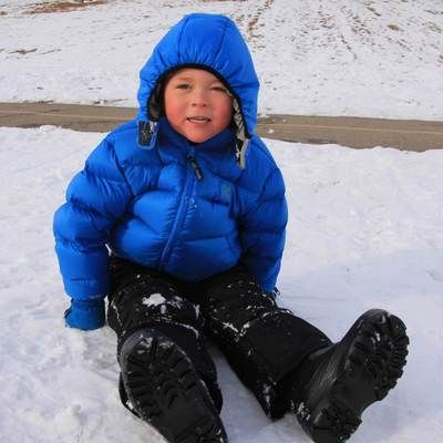 This affordable, quality winter jacket features a taffeta-lined hood and cozy insulation for the colder days. The water-resistant shell of the jacket will keep your kid warm and dry, too.
