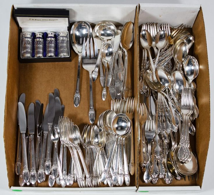 "Lot 131: Silverplate Flatware Assortment; Including an 1847 Rogers Bros. ""First Love"" set of (12) dinner knives, (12) butter knives, (10) dinner forks, (11) salad forks, (24) teaspoons, (12) soup spoons and (10) serving utensils; an (8) piece set of Wm. Rogers & Sons ""Victorian Rose;"" a (56) piece service from Wm. Rogers Mfg. Co. extra plate; two WA Italy serving utensils and a box of four F.B. Rogers silverplate shakers"