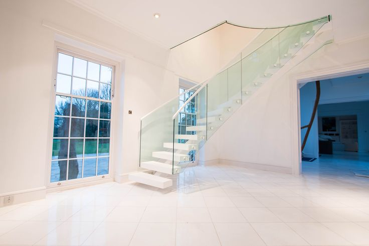A Luxury Middle Spine Staircase Which An Open Invitation