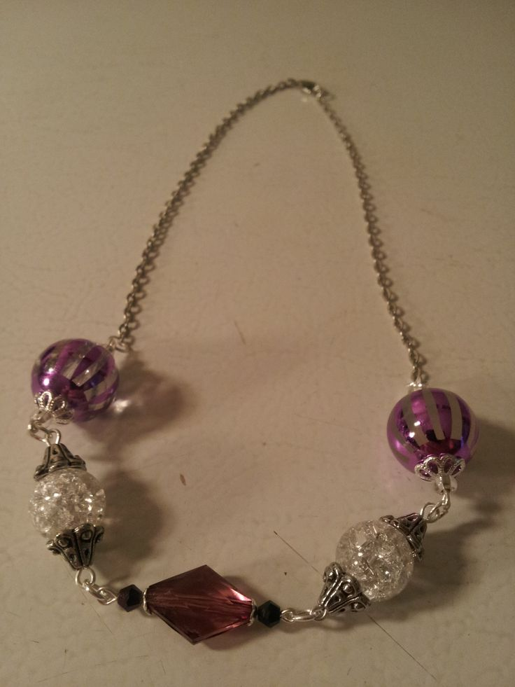 A simple amethyst coloured necklace, accented with crackled beads.