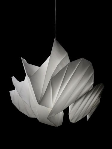 "Issey Miyake lamp. ""IN-EI ISSEY MIYAKE""  Lighting prototype. The material used is recycled polyester nonwoven fabric. The light is distinct in that it is without structure and created purely from folds."