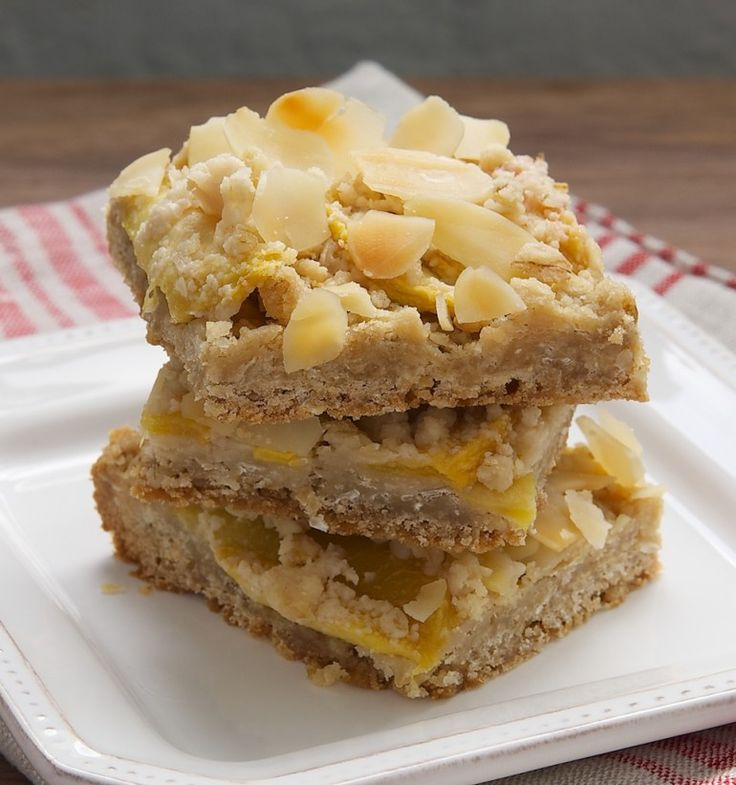 Peach Crumble Bars combine a buttery crust and crumble with fresh peaches for an irresistible sweet treat. - Bake or Break