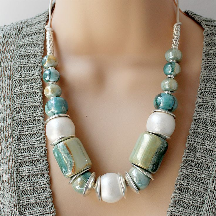 Gorgeous chunky Greek Ceramic Beads in aqua blue green are combined with large silver wooden beads strung onto a silver leather cord Perfect for