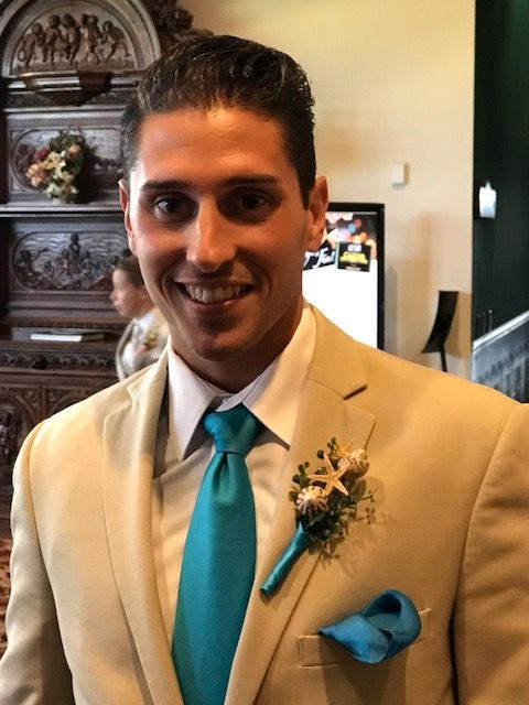 Chic shell boutonnieres on the guys for Chelsey and Charles' beach themed wedding at White Clay Creek Country Club.