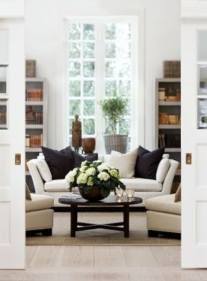 simple, relaxed living room. Pocket doors, earthy accents, and white by Janny Dangerous