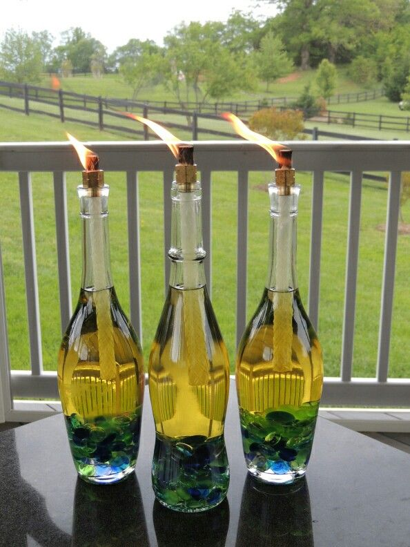"Directions: 1 empty and cleaned wine bottle - 1 Tiki Torch wick refill (thick) - Tiki Torch citronella lamp oil - 3/8"" diameter metal washer (or adjust washer size if bottle opening is larger/smaller) - Decorative glass - rocks or beads of your choice (optional) - Place the decorative rocks/beads in the bottle. The more you have, the less oil you will need to use and the sturdy your bottle will be."