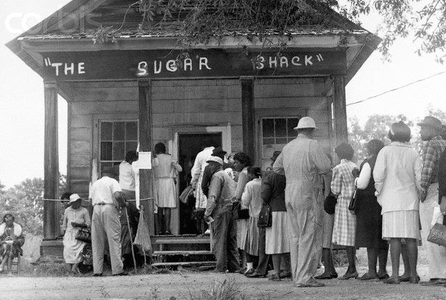 On Aug. 6, 1965, the Voting Rights Act was signed into law. African American voters in rural Wilcox Cty., Ala., able to vote for the FIRST time after the passage of the 1965 Voting Rights Act, line up in front of a polling station at The Sugar Shack. May, 1966  -IN MY LIFETIME-