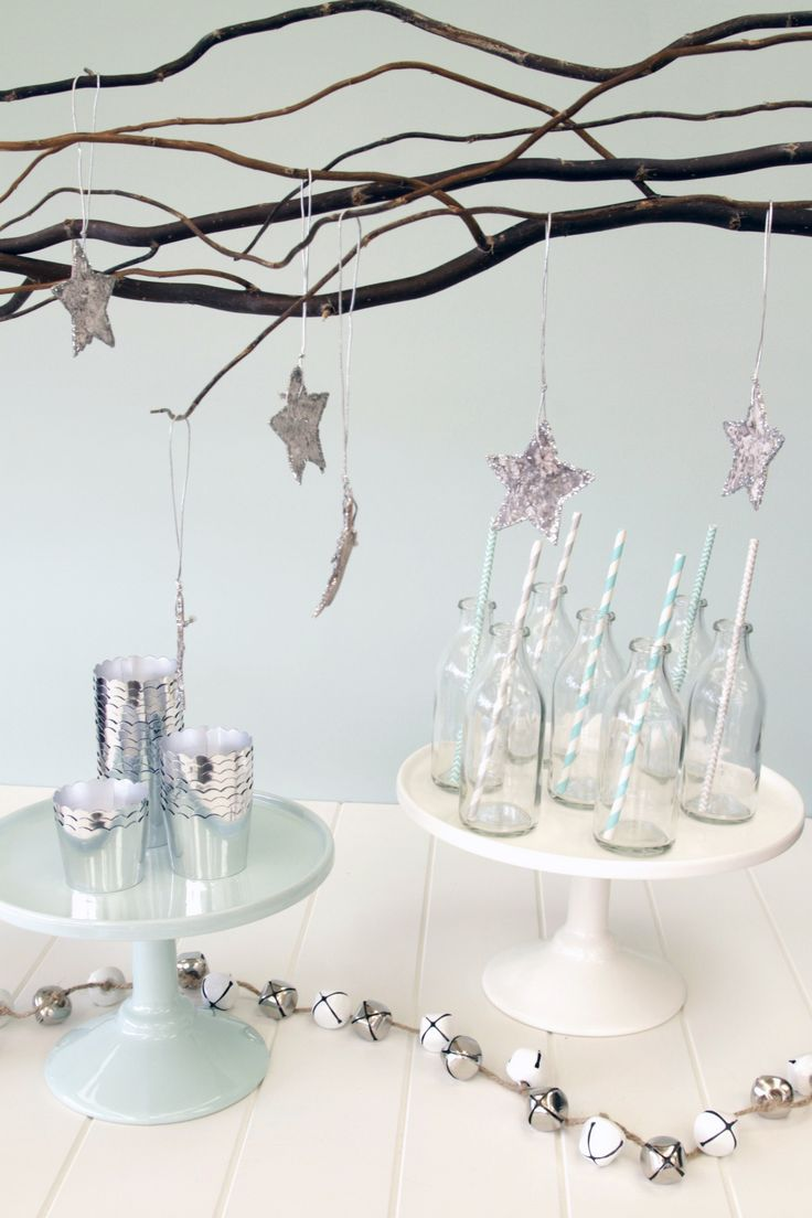 Mint and white Robert Gordon Cake Stands surrounded by silver Christmas accessories. Love this theme for a winter wonderland | Aqua Silver White Christmas Decorations | The Paper Lantern