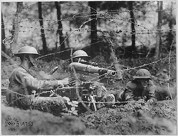 """History Basics: What Everyone Should Know About World War I: French """"37"""" in firing position on parapet in second-line trench. This gun has a maximum range of a mile and a half, is more accurate than a rifle, and is capable of firing 28 rounds a minute. Dieffmatten, Germany. (June 26, 1918)"""