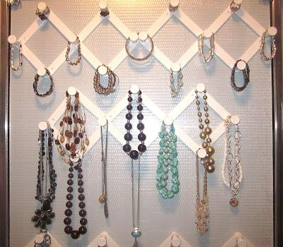 If you hate how much your bling tangles in a drawer, do as this woman has.This blogger found these accordion hooks at the Dollar Tree. then went to Staples and bought a roll of Command Double Sided tape. She hung them on the back of her doors and saved a bunch on a custom hanging jewelry organizer!
