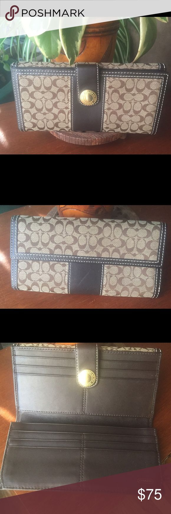 "Coach C Signature Bifold Wallet w/Leather Trim Coach C Signature Bifold Wallet Brown Jacquard Leather Trim   Approx. Measurements  •7 3/4"" Length  •4"" Height  •1"" Wide   Original retail price $248   Brown large signature ""C"" jacquard print with leather trim   •Gold tone hardware  •Coach signature lining                                        •12 credit card slots  •Bills slot; one coin slot at back •Two full length bill compartments  Flap and snap front closure  Pre-owned: excellent…"