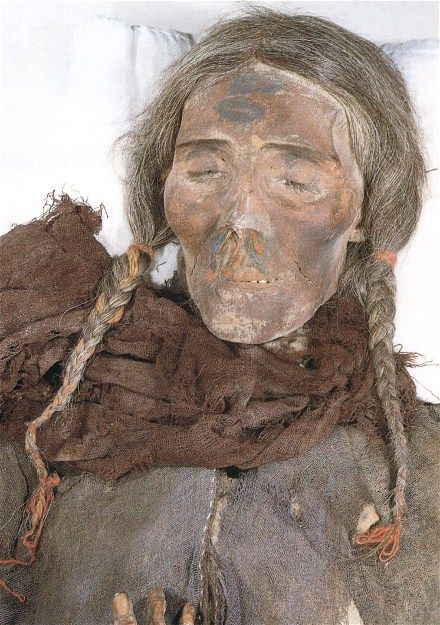 10 Ancient Faces – best preserved bodies of the last 5,000 years | this  Tocharian female is a Tarim mummy and lived around 1,000 BC.  She was tall, with a high nose and long flaxen blond hair, perfectly preserved in ponytails.  The weave of her clothing appears similar to Celtic cloth.  She was around 40 years-old when she died.