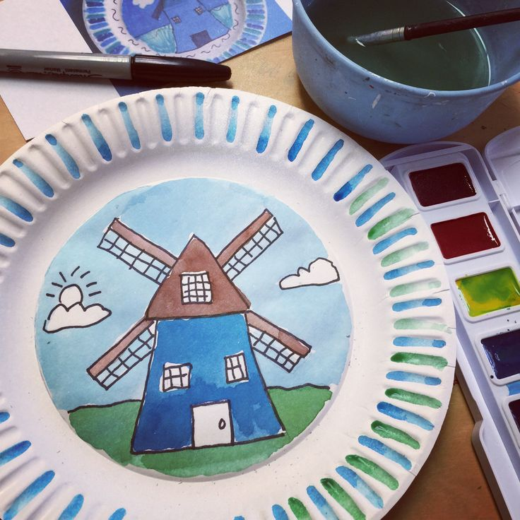 Dutch Windmill painted on an uncoated paper plate with watercolors #windmills #tpt