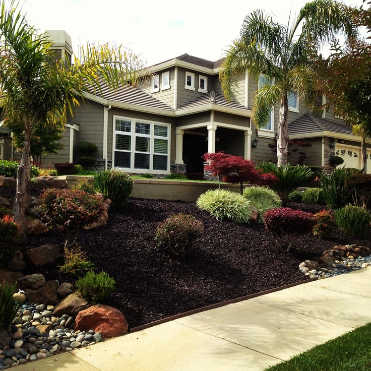 Use of rubber mulch (recycled tires) provides a good look; keeps its color; doesn't get blown around as easy as wood mulch; good for the environment.
