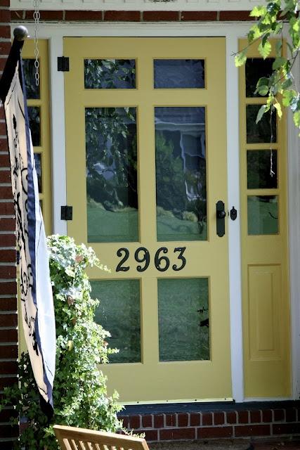 sunflower yellow for wood storm door, ORB hardware, & dark green main door