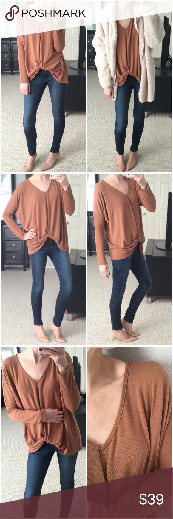"LAST 2▫️Camel Knotted Long Sleeve Top This color! 😍 Camel long sleeve top with v-neck and knot design on front. Such a cute spin in a basic. Great neutral color, perfect for colder months. Wide dolman sleeves. Great top for layering. Has a nice, texture to it, but is still soft and stretchy. Just love this one!  Modeling small. 60% cotton 40% rayon. Measurements as follows: Length: (S) 22/25"" (M) 22.5/26""  (L) 23/27"" *Bundle 2+ items for a discount. Tops Tees - Long Sleeve"