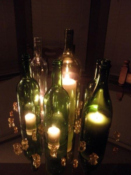 Lighted wine bottles.
