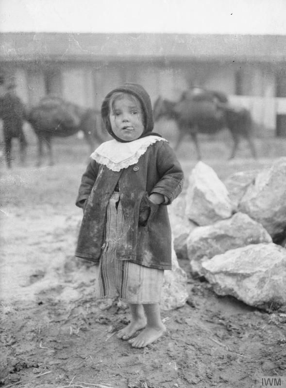 This is a photo from WW1. This child is from modern day Greece. You'll notice the lack of shoes, and generally poor surroundings.