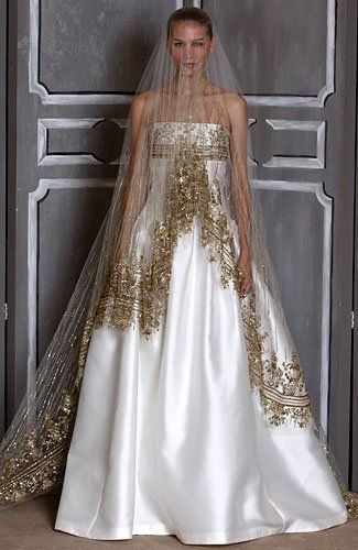 new bridal design by Carolina Herrera with golden veil