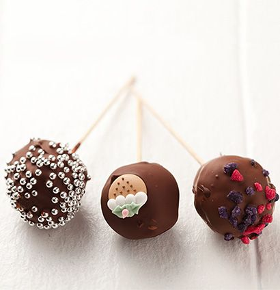 Called cake pops - cake mixed with cream cheese and coated in choc, then decorated. Dodgy!