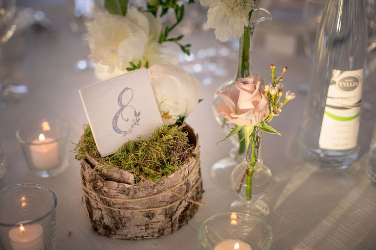 rustic centerpiece with wood and moss