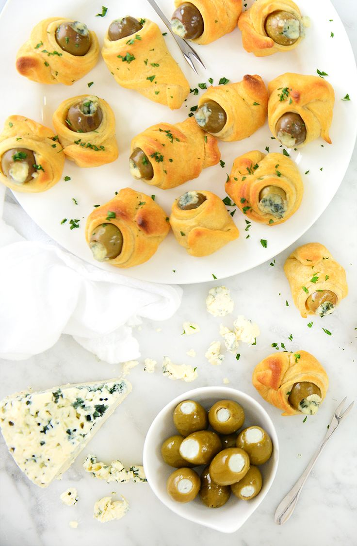 We take tart and briny olives stuffed with tangy blue cheese and wrap them up in a flaky puff pastry and bake. Easy, unique, ready to get the party started.