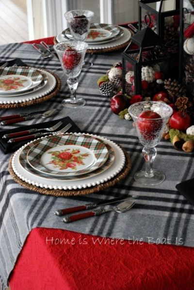 like the red tablecloth with the plaid over cloth.  the plaid plates are too much.