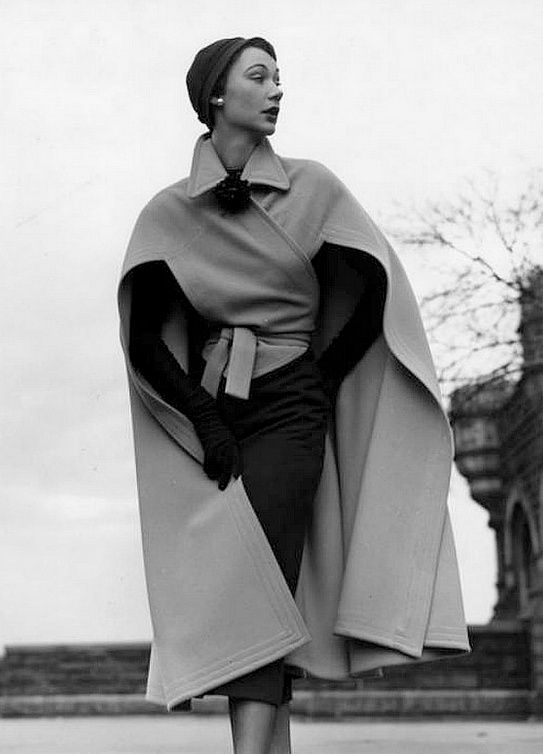 1952 Sophie Malgat in wool cape over wool dress by Bonnie Cashin for Neiman Marcus