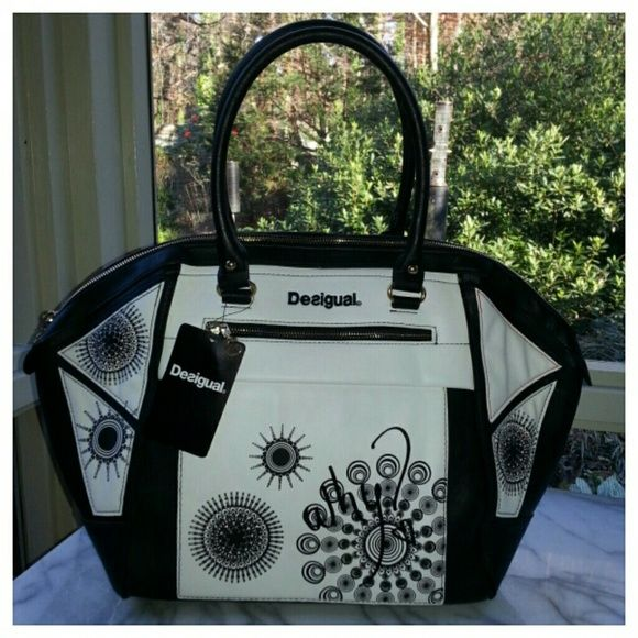 """Desigual Geo Monaco Satchel Large black and white vegan leather satchel with unique printed and embroidered design. 19"""" wide x 12.5"""" high x 5"""" deep. One exterior zip pocket in front, one exterior slip pocket in back, fabric lined interior with one zip pocket and two slip pockets. Zip closure, metal feet on bottom for stability, 8"""" strap drop. Desigual Bags Satchels"""