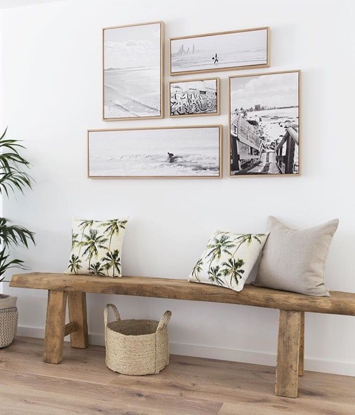 gallery wall with black & white photos, gorgeous bench seat, beachy look