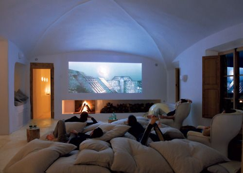 How cozy & simple is this media room? A fireplace, projector screen & a ton of plush pillows.