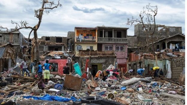 Destroyed buildings and trees with belongings strewn over the ground in the town of Jeremie, Haiti on 6 October 2016