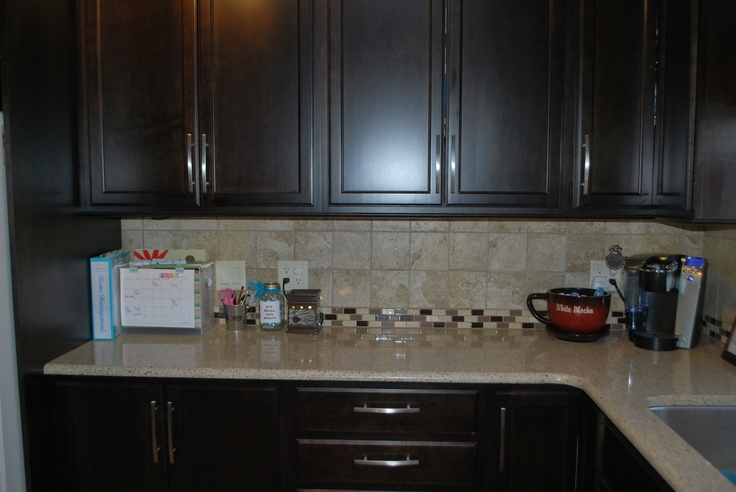 Thanks to @Toni Hammersley (A Bowl Full of Lemons) and her idea, my counters stay clutter free!...........I like the backsplash.