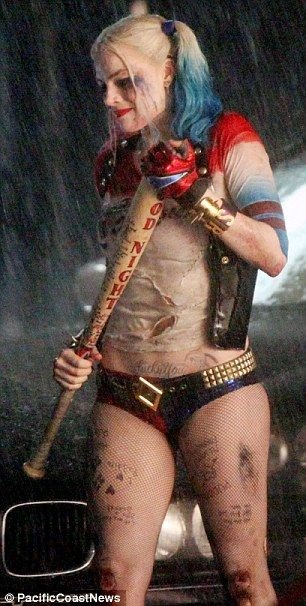 In the wars: Harley Quinn looked as if she'd been in a bit of a scrape with grazes on her knees and a bloodied gash on her forehead and she held on tight to her baseball bat weapon