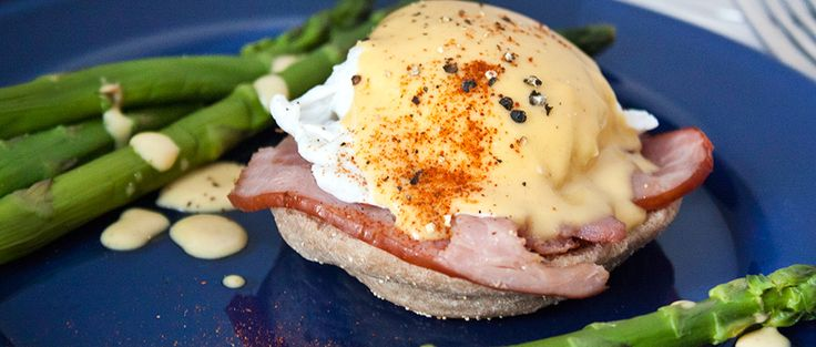 Make mom's brunch better than ever with this healthier eggs benedict recipe served with fresh asparagus on a whole-wheat English muffin.