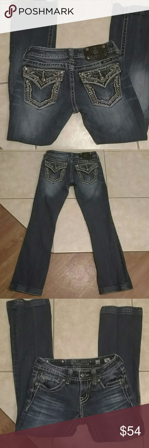 Miss me jeans Great pair of Miss me jeans size 25 hemmed to a inseam of 29 inches. Only missing one rivet on patch. Back pockets have pretty little bling and brown threading. Rise is 6 inches and waist flat measures 14 inches. 98% cotton 2% elastane Miss Me Jeans Boot Cut