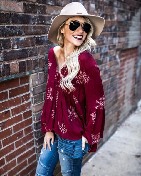 Get boho in our Flora Bell Sleeve Baby Doll Top! This beauty is baby doll style with stitched florals throughout. The wine hue is accented with white stitching for a cute contrast. The empire waist is