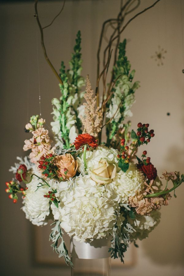 elegant floral arrangement // photo by @Tara Harmon Kneiser http://ruffledblog.com/1920s-inspired-knoxville-wedding #flowers #centerpieces #weddingideas