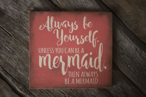 This Always Be a Mermaid sign is painted on a coral, distressed background. A sawtooth hanger is attached to the back and ready to hang. This sign does not have a sealant on it, and is not recommended for outdoors.  DETAILS: • ivory on coral background • made of Baltic Birch • 5/8 thickness • 12.75 (w) x 11.875 (h)  I DO accept orders for custom variations on size and color. *Price will vary on custom orders.  PLEASE NOTE: No two signs will be EXACTLY alike. Each one is painted and distr...