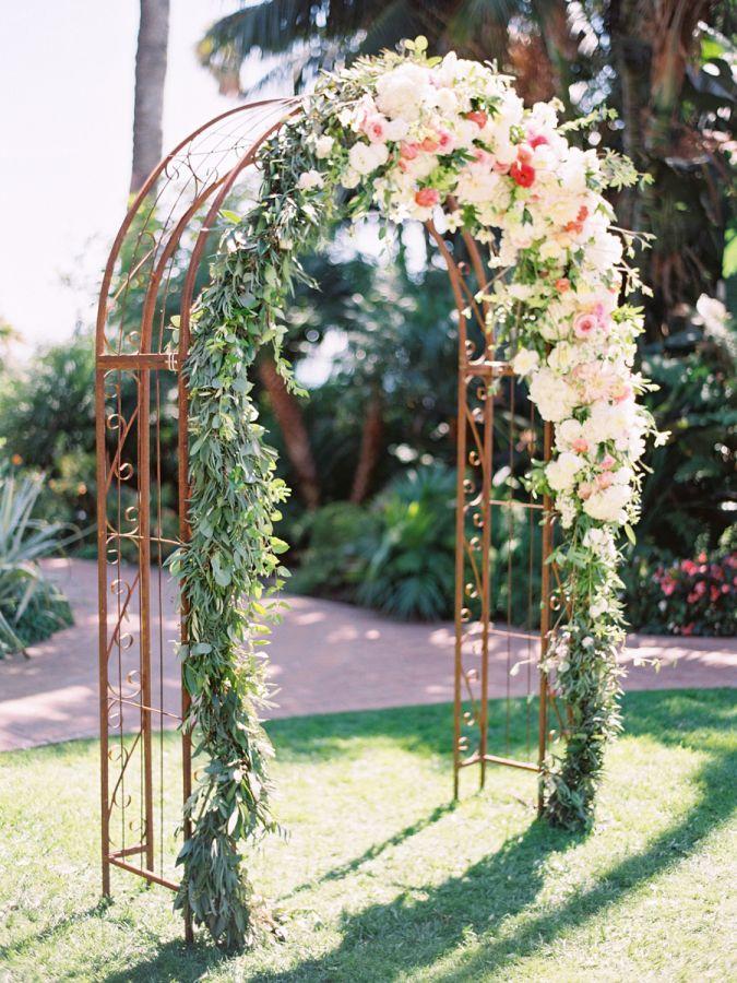 Garden floral covered ceremony arch: http://www.stylemepretty.com/california-weddings/santa-barbara/2016/01/21/elegant-four-seasons-resort-wedding/   Photography: Michael + Anna Costa - http://michaelandannacosta.com/