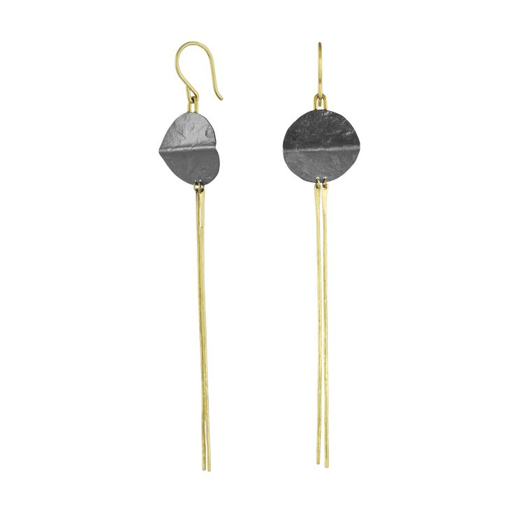 Spine Disc Bar Dangles by Sophie Hughes. Sophisticated and striking, these hand-fabricated earrings pair long, slender bars of 18k gold with folded discs of oxidized sterling silver, all enlivened by a rich hammered texture. 18k gold ear wires.