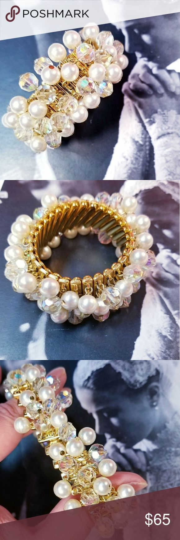 "Vintage Aurora Borealis faux pearl bracelet. Vintage rainbow Aurora Borealis crystal and faux pearl accordion expansion stretch bracelet. Gold tone hardware. Stamped Japan on interior. Stretches to about 10"" and is just over 1"" wide. Matching earrings available. Perfect for weddings or other formal events. All crystals and pearls are present and intact. Excellent vintage condition reasonable offers welcome and accepted. Add to a bundle and I'll offer you a great deal Vintage Jewelry…"