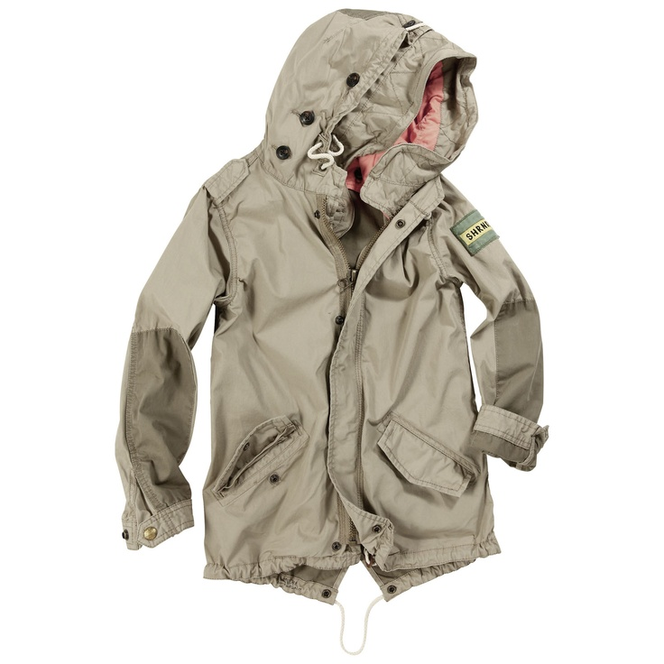 Light mid-season parka made of beige canvas without lining. Zip fastening under a press-stud placket. Hood with a removable buttoned lining. Pockets with buttoned flaps. Patch over the left sleeve.